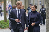 Meghan Markle and Prince Harry leave the National September 11 Memorial & Museum in New York, Thursday, Sept. 23, 2021. (AP Photo/Seth Wenig)