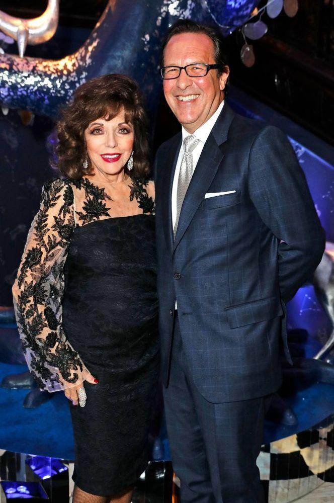 Joan Collins and Percy Gibson | David M. Benett/Dave Benett/Getty Images