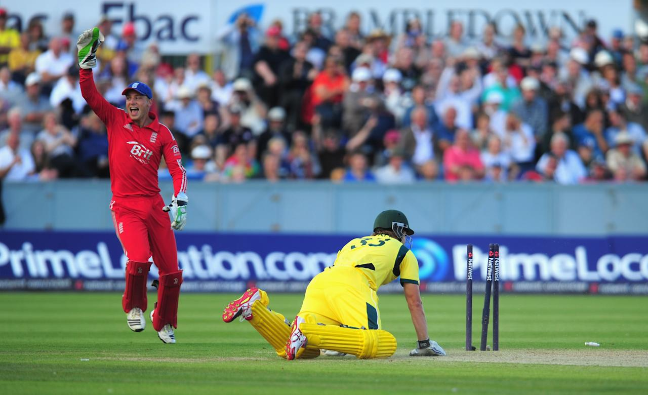 CHESTER-LE-STREET, ENGLAND - AUGUST 31:  Australia batsman Shane Watson is run out as wicketkeeper Jos Buttler celebrates during the 2nd NatWest series T20 match between England and Australia at Emirates Durham ICG on August 31, 2013 in Chester-le-Street, England.  (Photo by Stu Forster/Getty Images)