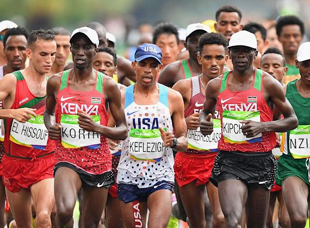 Kenyan marathoners Wesley Korir (left) and Eilud Kipchoge sandwich U.S. distance star Meb Keflezighi in Rio. (Getty Images)