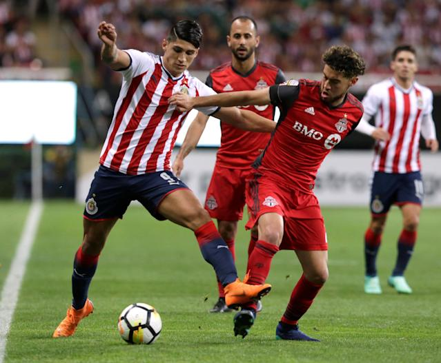 Soccer Football - CONCACAF Champions League Final Second Leg - Guadalajara vs Toronto FC - Estadio Akron, Guadalajara, Mexico - April 25, 2018 Guadalajara's Alan Pulido in action with Toronto's Jonathan Osorio REUTERS/Henry Romero