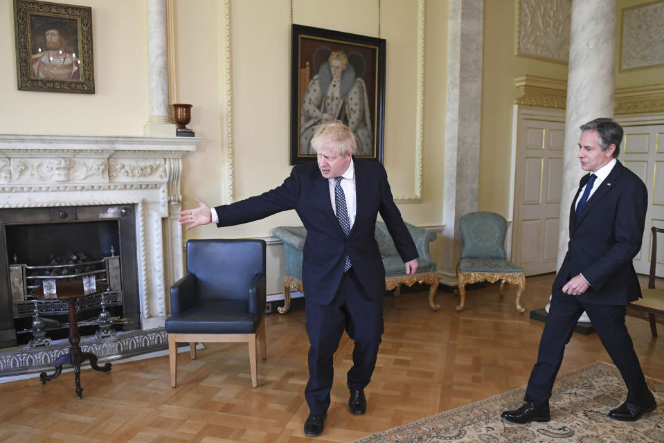 Britain's Prime Minister Boris Johnson, left, and US Secretary of State Antony Blinken inside 10 Downing Street in London, Tuesday, May 4, 2021. Foreign ministers from the Group of Seven wealthy industrialized nations gathered in London to grapple with threats to health, prosperity and democracy. It is their first face-to-face meeting in more than two years. (Stefan Rousseau/Pool via AP)