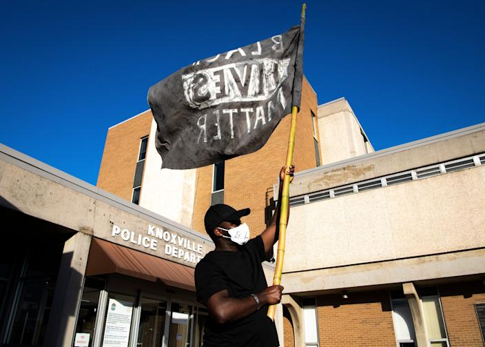 A Black Lives Matter flag is flown in front of the Knoxville Police Department headquarters May 29 in Tennessee as people gather for a rally in solidarity with Minneapolis to speak out against police brutality.