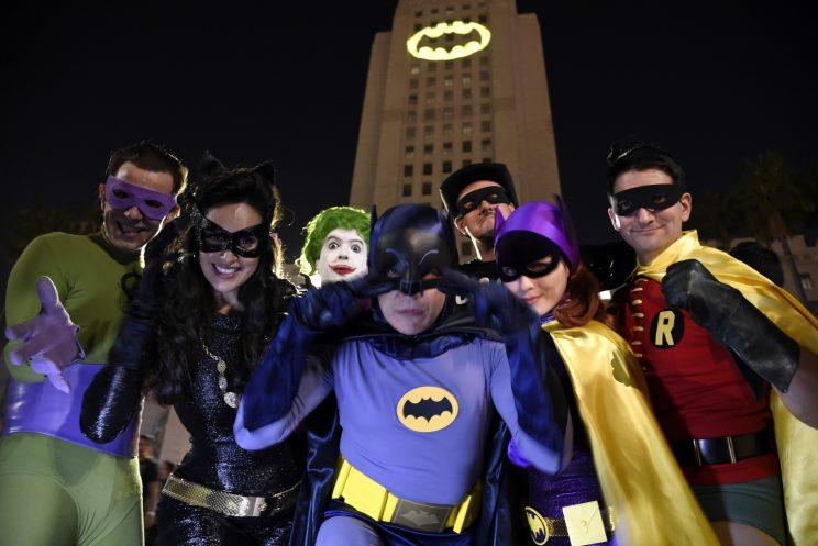 Bat signal... fans flocked to the City Hall in Los Angeles to see the Bat Signal turned on in memory of Adam West - Credit: AP