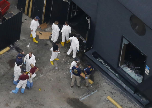 <p>Police forensics investigators work at the crime scene of a mass shooting at the Pulse gay night club in Orlando, Florida, U.S. June 12, 2016. (REUTERS/Carlo Allegri) </p>