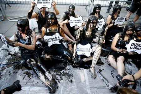 With glue and fake blood, climate protesters target London Fashion Week