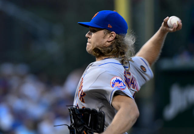 New York Mets starting pitcher Noah Syndergaard delivers during the first inning of a baseball game against the Chicago Cubs on Monday, Aug. 27, 2018, in Chicago. (AP Photo/Matt Marton)