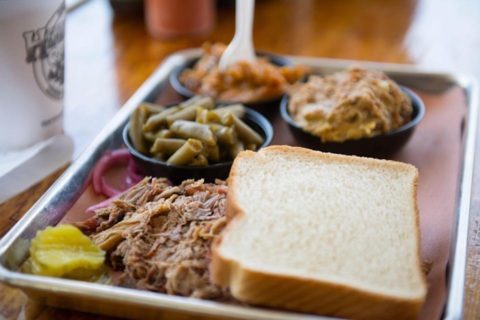 A tray of pulled pork sits on a table at Henry's Smokehouse on Thursday, April 19, 2018.