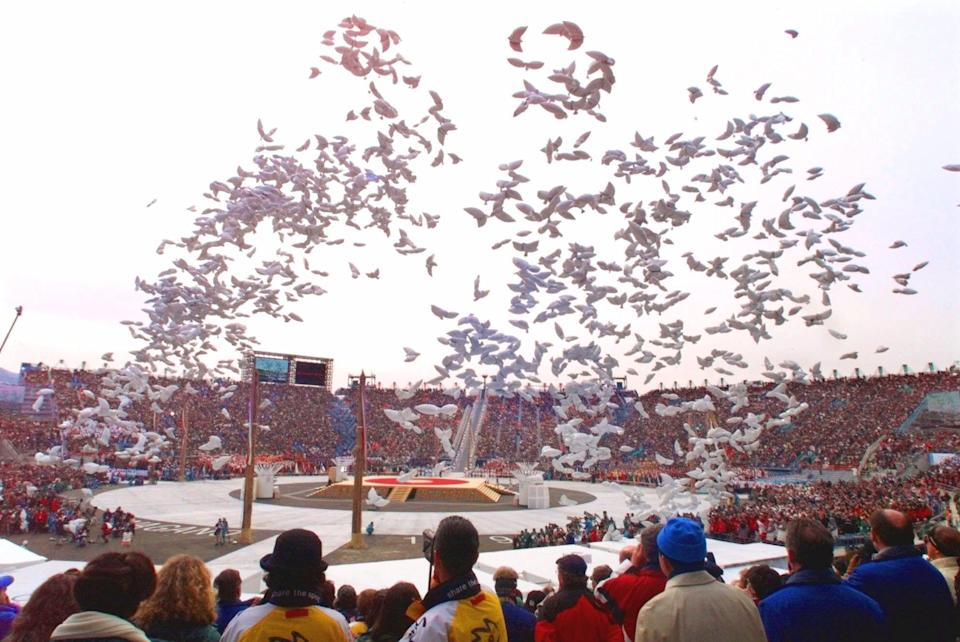Balloons in the shape of doves fly past spectators at the conclusion of the opening ceremony of the Winter Olympics in Nagano, Japan, Saturday, Feb. 7, 1998.