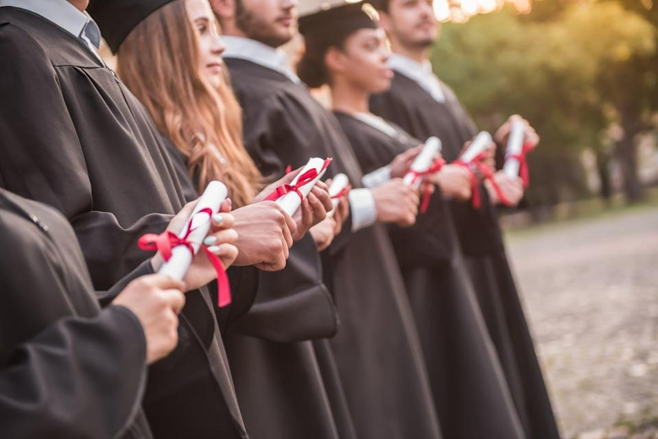 """<span class=""""caption"""">Colleges are increasingly being judged on how many students graduate. But is tying funding to graduation rates the way to go?</span> <span class=""""attribution""""><a class=""""link rapid-noclick-resp"""" href=""""https://www.shutterstock.com/image-photo/successful-graduates-academic-dresses-holding-diplomas-739232275"""" rel=""""nofollow noopener"""" target=""""_blank"""" data-ylk=""""slk:George Rudy/Shutterstock.com"""">George Rudy/Shutterstock.com</a></span>"""