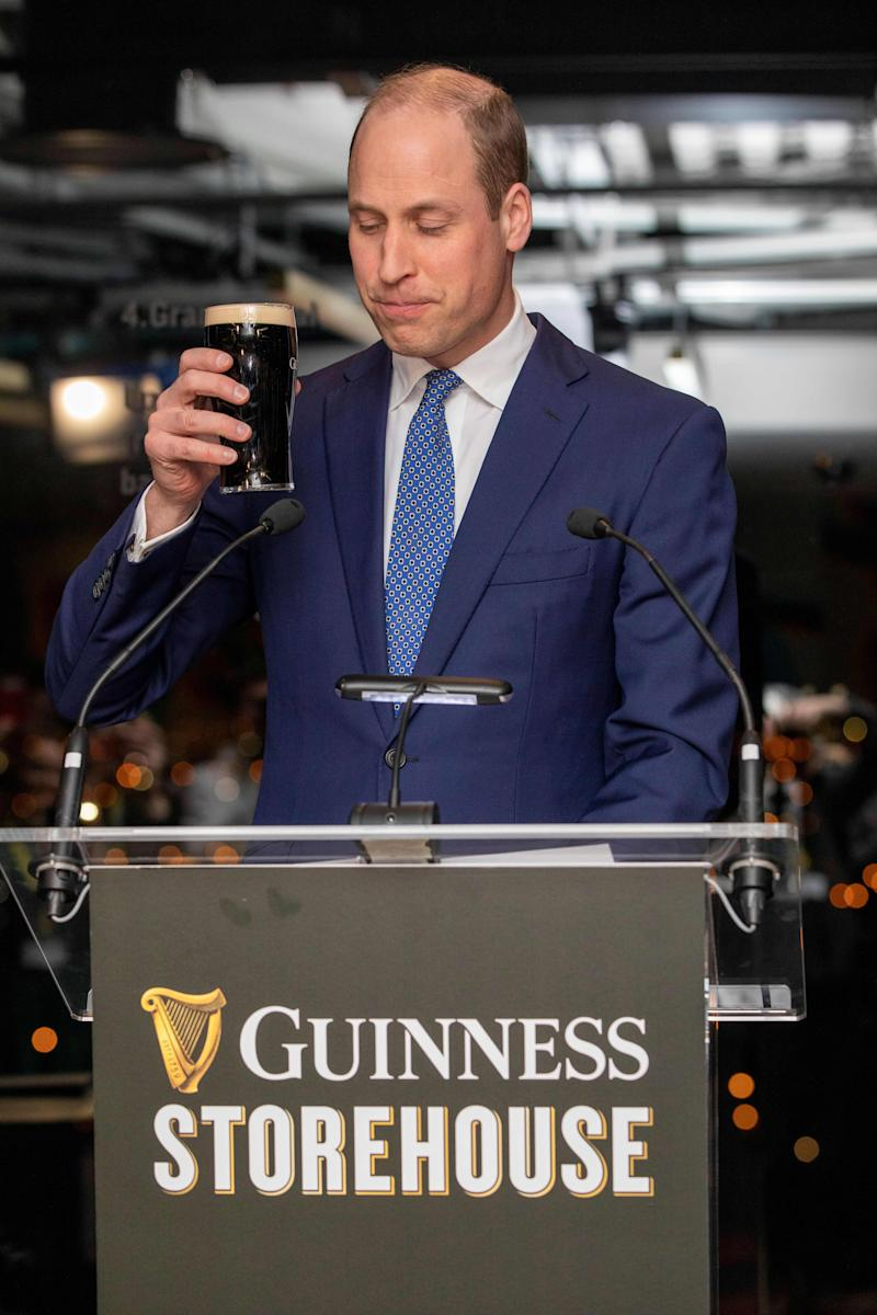Britain's Prince William, Duke of Cambridge holds a pinto f Guinness as he attends a special reception at the Guinness Storehouses Gravity Bar in Dublin on March 3, 2020 on the first day of their Royal Highnesses three-day visit. (Photo by PAUL FAITH / POOL / AFP) (Photo by PAUL FAITH/POOL/AFP via Getty Images)