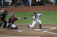 Virginia catcher Logan Michaels (12) SAC bunts the ball advancing Jake Gelof, not pictured, to second base against Mississippi State in the second inning during a baseball game in the College World Series Tuesday, June 22, 2021, at TD Ameritrade Park in Omaha, Neb. (AP Photo/John Peterson)