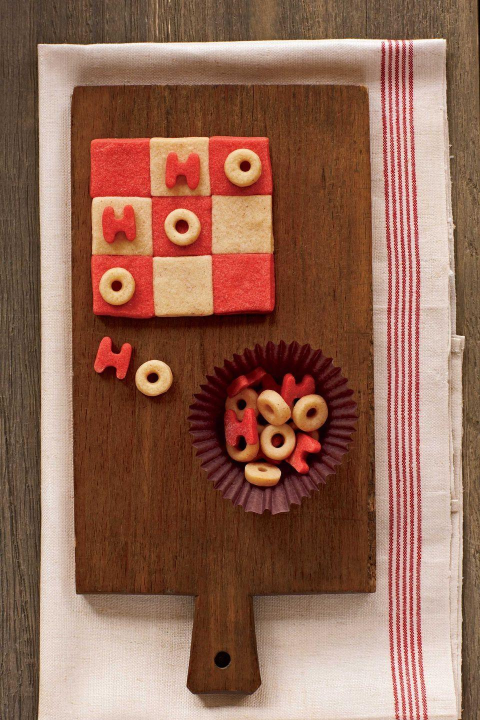 """<p>Begin by pressing together nine 1 1/4-inch squares of dough to make the tic-tac-toe game board, and cut out plenty of <em>H</em>s and <em>O</em>s. The tiny letters will bake very quickly, so keep watch to prevent them from overbrowning.</p><p><strong><a href=""""https://www.countryliving.com/food-drinks/recipes/a2022/sugar-cookie-dough-clv1207/"""" rel=""""nofollow noopener"""" target=""""_blank"""" data-ylk=""""slk:Get the recipe"""" class=""""link rapid-noclick-resp"""">Get the recipe</a>.</strong></p>"""