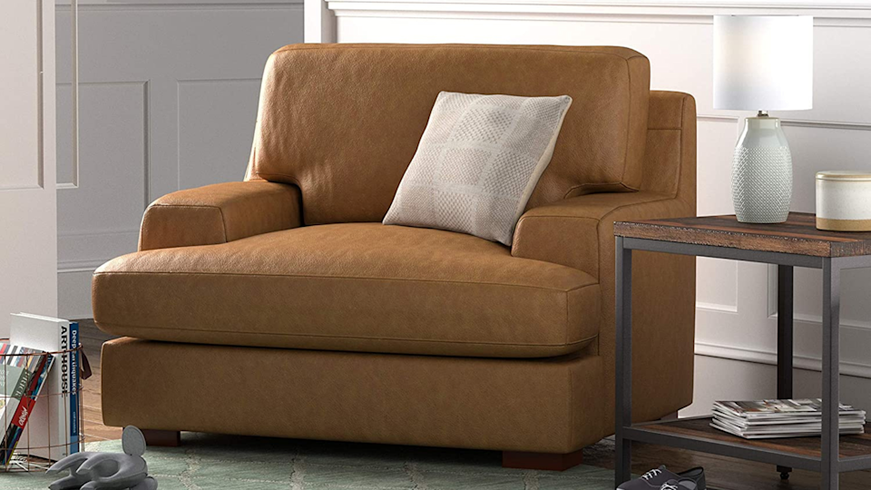 Let this oversized armchair engulf you in comfort.