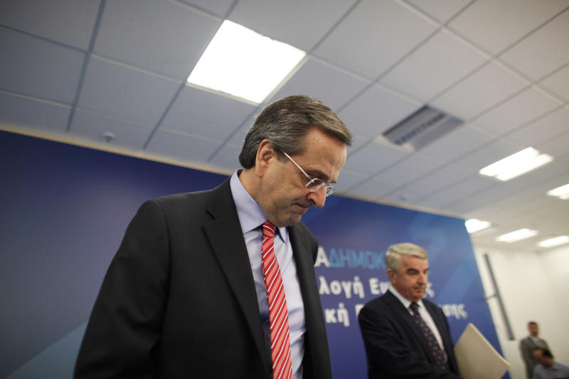 "Greek Prime Minister Antonis Samaras arrives at the headquarters of the conservative ""New Democracy"" party to address his parliamentary group of lawmakers about the upcoming vote on the new round of austerity measures next week, in Athens, Sun. Nov. 4 2012. Greece's coalition government is struggling to push through a new round of austerity measures that is set to impose new wage, pension, and benefit cuts on a public already plagued by 25 percent unemployment. (AP Photo/Kostas Tsironis)"