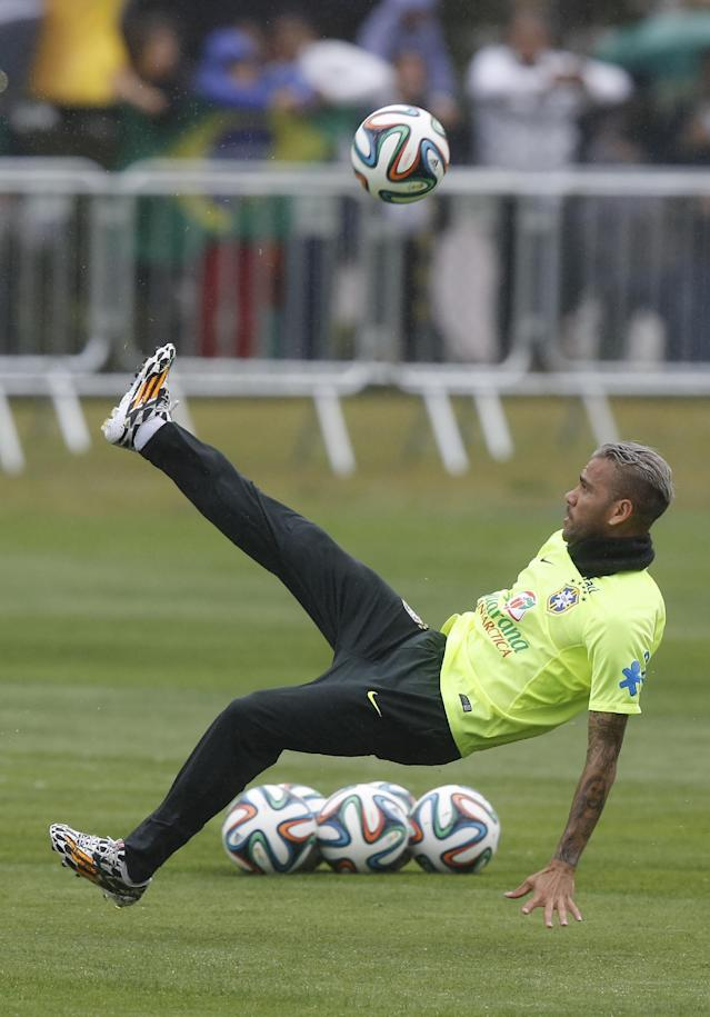 Brazil's Daniel Alves kicks the ball during practice at the Granja Comary training center in Teresopolis, Brazil, Friday, July 11, 2014. Brazil will face the Netherlands in the World Cup third-place match Saturday. (AP Photo/Leo Correa)