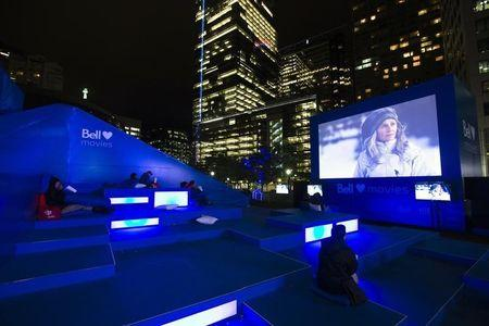 People watch a movie outdoors in Pecaut Square during the 38th Toronto International Film Festival in Toronto