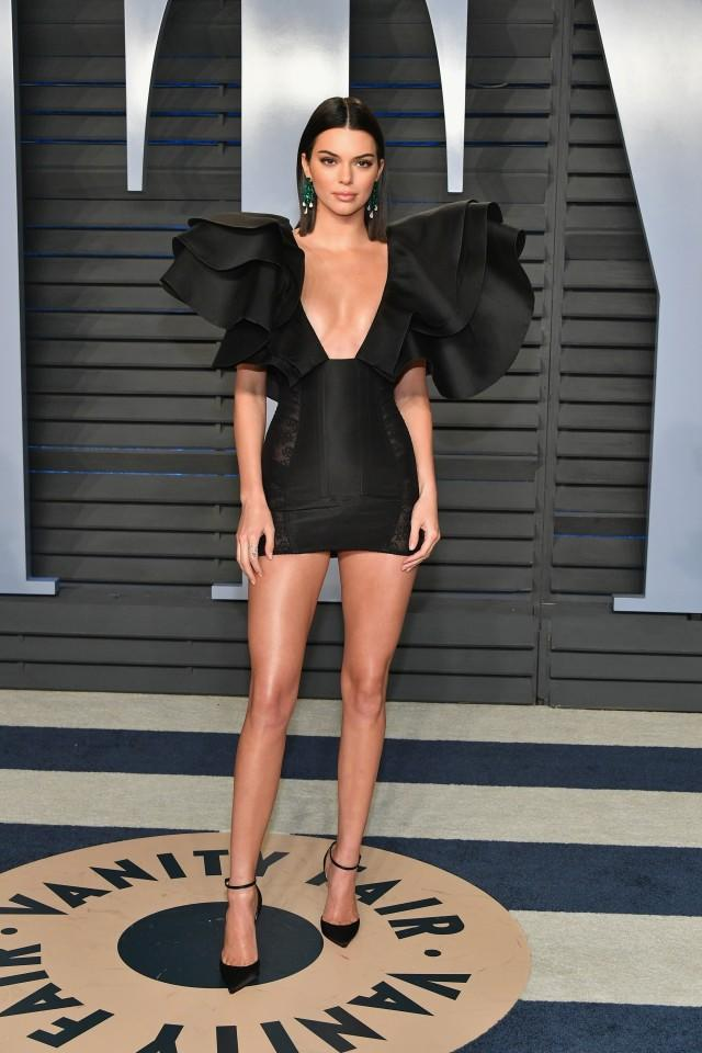 Kendall Jenner attends the Vanity Fair Oscars after-party in a black minidress