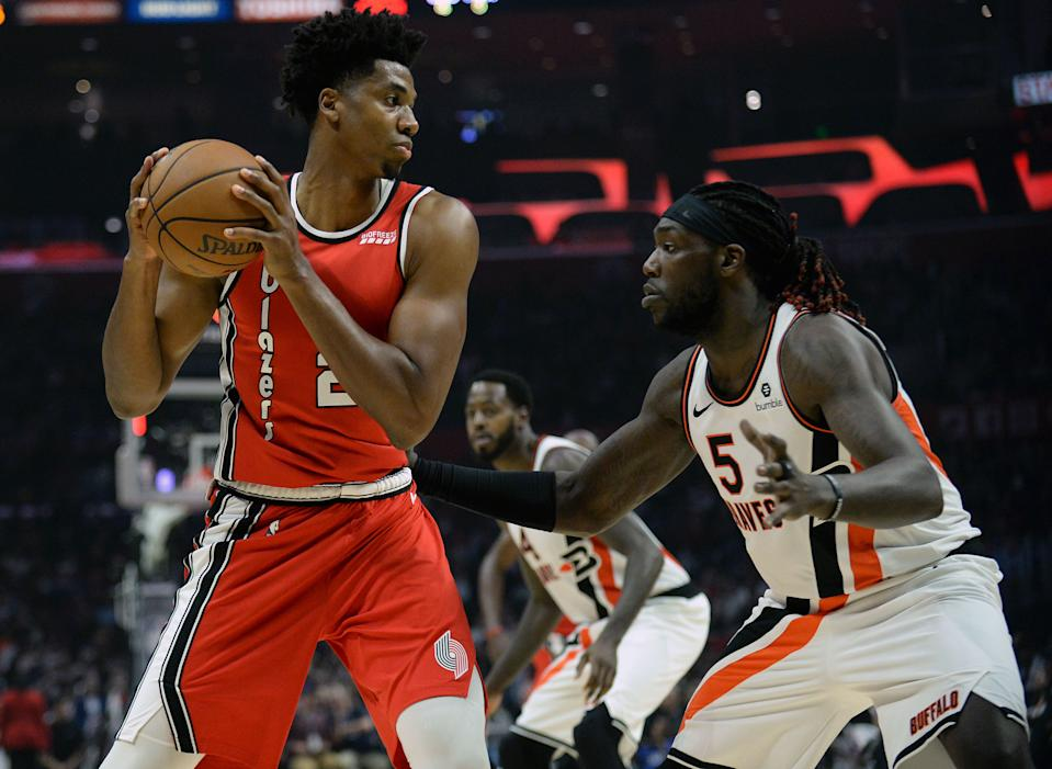 November 7, 2019; Los Angeles, CA, USA; Portland Trail Blazers center Hassan Whiteside (21) controls the ball against Los Angeles Clippers forward Montrezl Harrell (5) during the second half at Staples Center. Mandatory Credit: Gary A. Vasquez-USA TODAY Sports