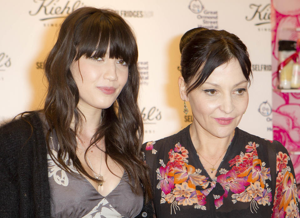 British Fashion designer Pearl Lowe, right and her daughter, British model Daisy Lowe pose for photographs before they sign bottles of their charity edition body cream, at a central London store, Thursday, March 15, 2012. Profits from each sale go towards the Great Ormond Street Hospital Children's Charity. (AP Photo/Joel Ryan)
