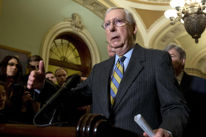 Senate Majority Leader Mitch McConnell, R-Ky., accompanied by other senators, speaks during a news conference outside of the Senate chamber, on Capitol Hill in Washington, Tuesday, Jan. 14, 2020. (AP Photo/Jose Luis Magana)