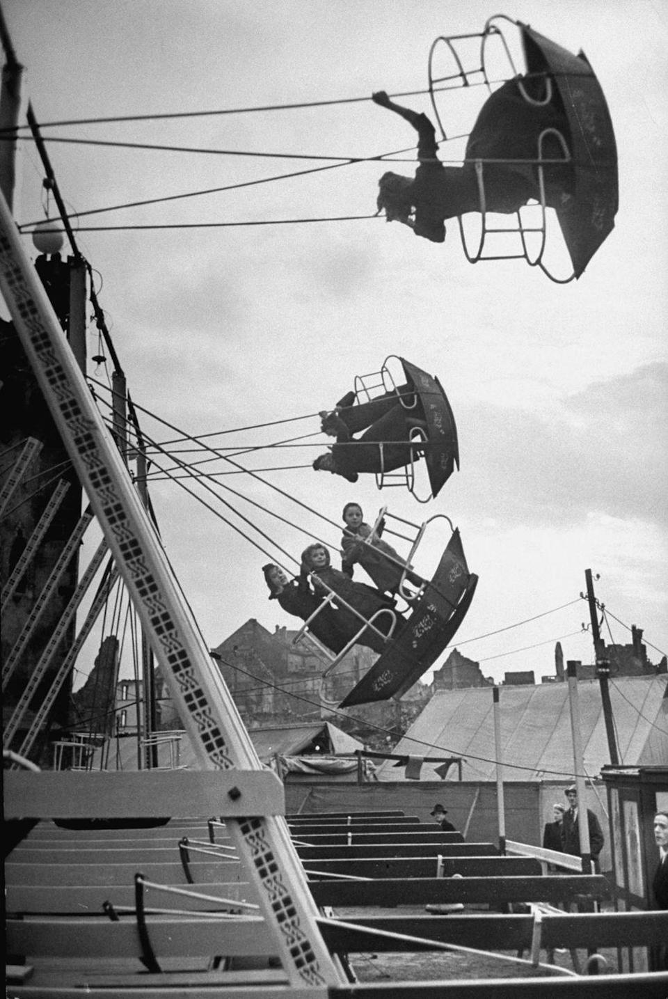 <p>The location of this photo is unknown, but you can see that this swing ride does not require riders to sit down — you just stand up and hold on for dear life. </p>