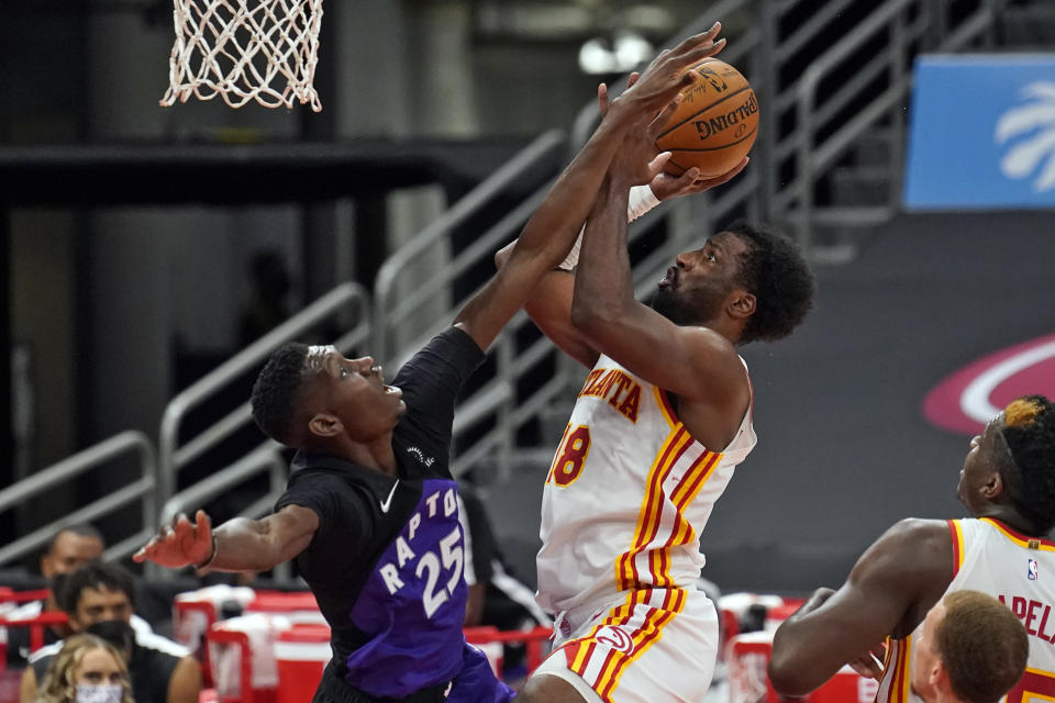 Atlanta Hawks forward Solomon Hill (18) shoots in front of Toronto Raptors forward Chris Boucher (25) during the second half of an NBA basketball game Tuesday, April 13, 2021, in Tampa, Fla. (AP Photo/Chris O'Meara)