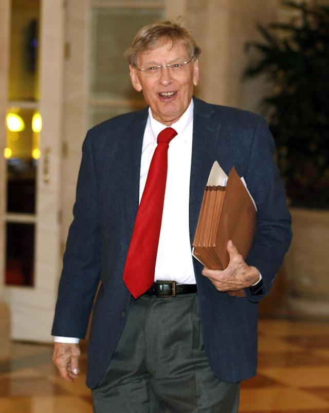 Major League Baseball Commissioner Bud Selig heads for morning meetings at baseball's general managers' meetings Thursday, Nov. 14, 2013, in Orlando, Fla. (AP Photo/Reinhold Matay)