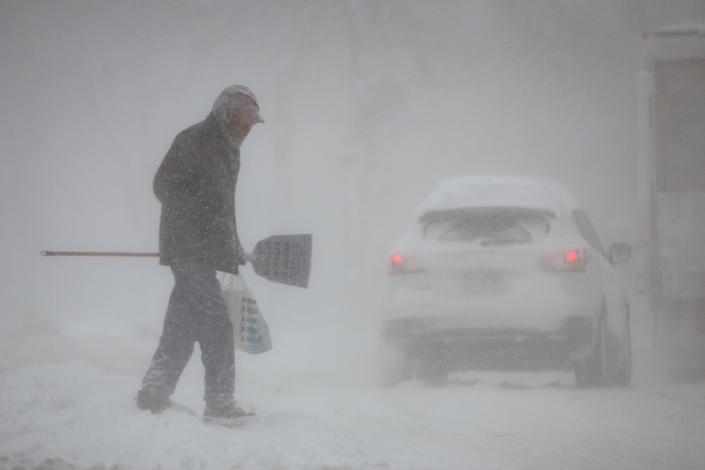 A man crosses a street in whiteout conditions during a winter storm in Buffalo, N.Y, on Jan. 30, 2019. (Photo: Lindsay Dedario/Reuters)