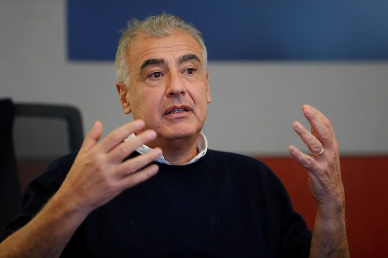 FILE PHOTO: Marc Lasry, an American billionaire businessman and co-founder and chief executive officer of Avenue Capital Group speaks during a Reuters investment summit in New York City
