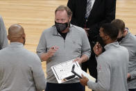 Milwaukee Bucks head coach Mike Budenholzer, center, talks strategy with assistants during a timeout in the second half of an NBA basketball game against the Minnesota Timberwolves, Wednesday, April 14, 2021, in Minneapolis. The Bucks won 130-105. (AP Photo/Jim Mone)
