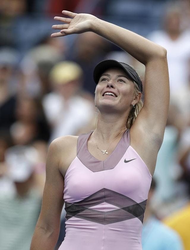 Maria Sharapova of Russia waves to fans after beating Marion Bartoli, of France, in the quarterfinals during the 2012 US Open tennis tournament, Wednesday, Sept. 5, 2012, in New York. (AP Photo/Darron Cummings)