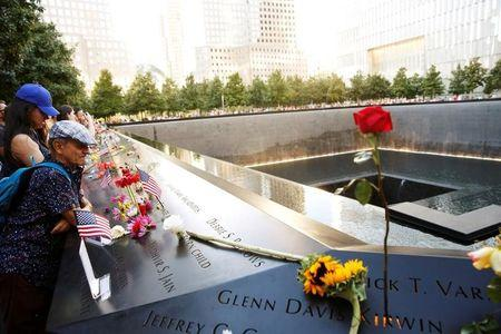 FILE PHOTO: Visitors look out over the National September 11 Memorial and Museum on the 15th anniversary of the 9/11 attacks in Manhattan, New York, U.S. on September 11, 2016.  REUTERS/Lucas Jackson/File Photo