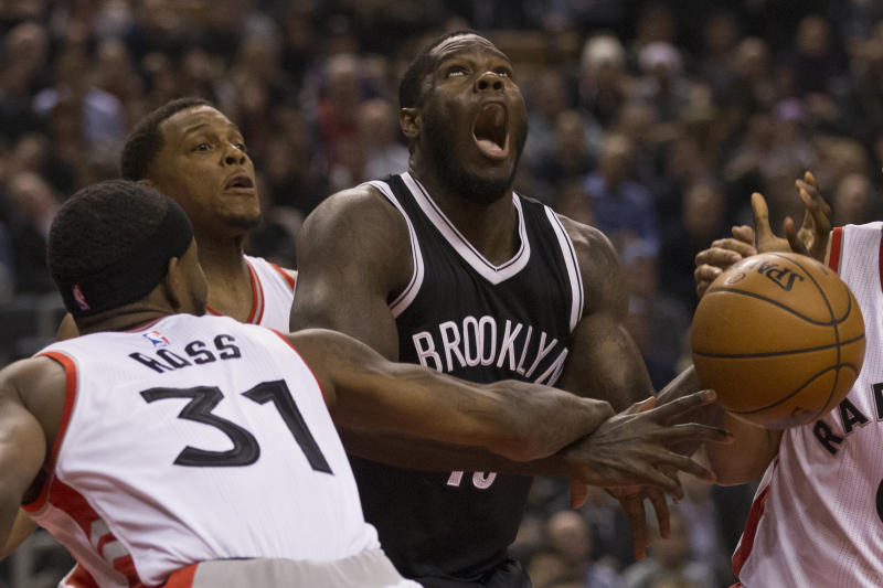 TORONTO, ON - DECEMBER 20: Toronto Raptors forward Terrence Ross (31) hammers Brooklyn Nets forward Anthony Bennett (13) and gets the foul. Toronto Raptors vs Brooklyn Nets in 1st half action of NBA regular season play at Air Canada Centre. Toronto Star/Rick Madonik (Rick Madonik/Toronto Star via Getty Images)