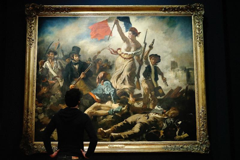 "Facebook apologised in March for temporarily removing an advert featuring French artist Eugene Delacroix's famous work ""Liberty Leading the People"" because it depicts a bare-breasted woman (AFP Photo/PATRICK KOVARIK)"