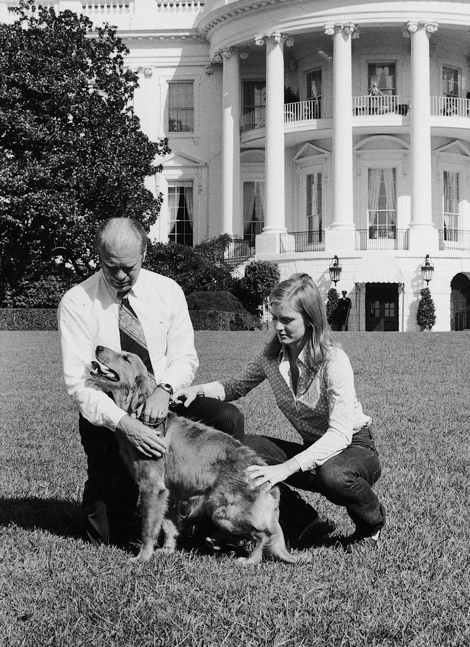 <p>President Gerald Ford and his daughter Susan play with their Golden Retriever, named Liberty, on the White House lawn in October 1974.</p>