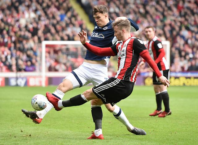 "Soccer Football - Championship - Sheffield United vs Millwall - Bramall Lane, Sheffield, Britain - April 14, 2018 Sheffield United's Lee Evans in action with Millwall's Jake Cooper Action Images/Paul Burrows EDITORIAL USE ONLY. No use with unauthorized audio, video, data, fixture lists, club/league logos or ""live"" services. Online in-match use limited to 75 images, no video emulation. No use in betting, games or single club/league/player publications. Please contact your account representative for further details."