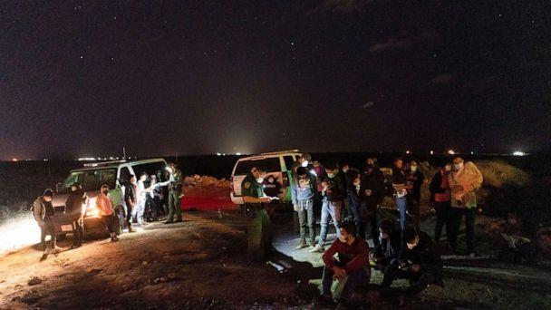 PHOTO: Asylum-seeking migrants' families wait to be transported by the U.S. Border Patrols after crossing the Rio Grande river into the United States from Mexico in Roma, Texas, April 5, 2021.  (Go Nakamura/Reuters)