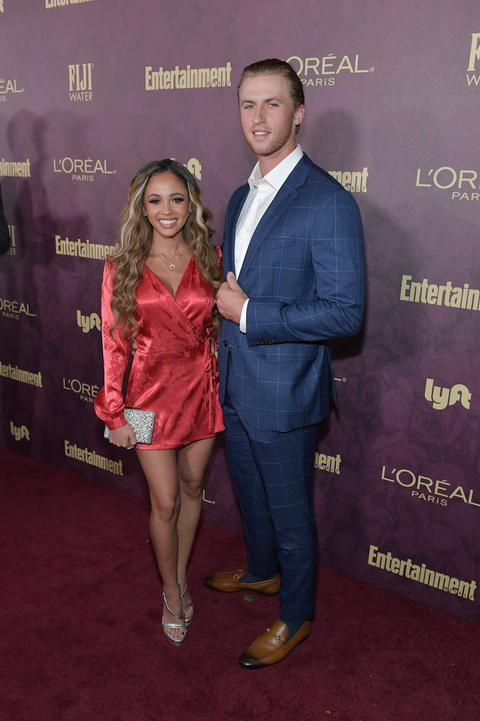 LOS ANGELES, CA - SEPTEMBER 15: Vanessa Morgan (L) and Michael Kopech attend the 2018 Pre-Emmy Party hosted by Entertainment Weekly and L'Oreal Paris at Sunset Tower on September 15, 2018 in Los Angeles, California. (Photo by Neilson Barnard/Getty Images for Entertainment Weekly)