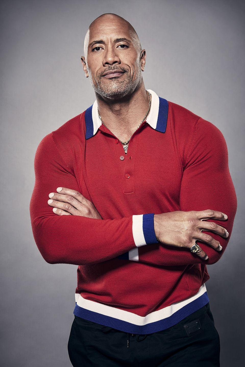 "<p>The Rock may be hiding his bugling biceps under a long sleeve shirt, but we can still tell he's got one crazy flex going on. The professional wrestler turned movie star is extremely dedicated to his fitness regime and <a href=""https://www.menshealth.com/fitness/a32266684/the-rock-dwayne-johnson-workout-split-quarantine/"" rel=""nofollow noopener"" target=""_blank"" data-ylk=""slk:recently released a new quarantine program"" class=""link rapid-noclick-resp"">recently released a new quarantine program</a>. </p>"