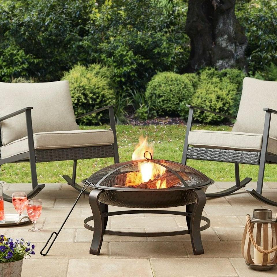 <p>The <span>Mainstays Owen Park Round Wood-Burning Fire Pit</span> ($42) makes backyard bonfires easy and enjoyable for everyone.</p>