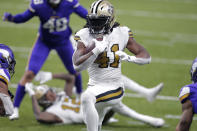 New Orleans Saints running back Alvin Kamara (41) carries for his fourth touchdown of the game, in the second half of an NFL football game against the Minnesota Vikings in New Orleans, Friday, Dec. 25, 2020. (AP Photo/Brett Duke)