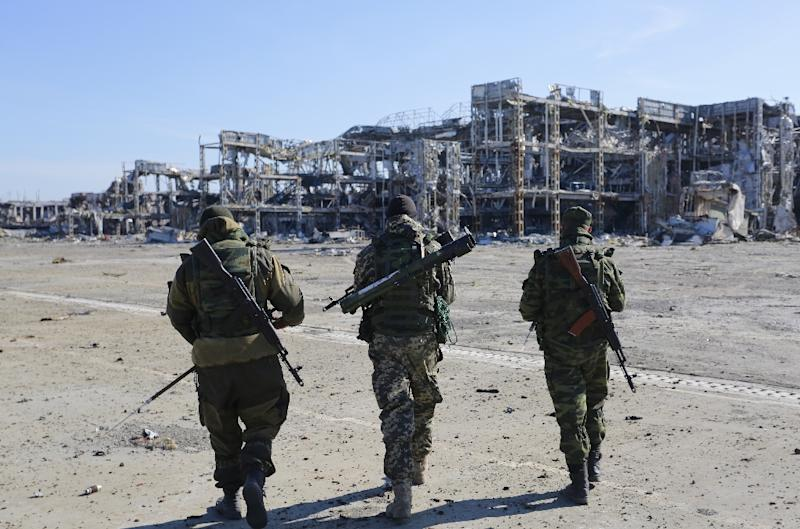 Pro-Russian rebels walk in the direction of the destroyed Donetsk international airport, which Ukrainian forces lost control of in January 2015 (AFP Photo/Aleksey Filippov)