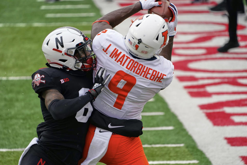 Nebraska safety Deontai Williams (8) pushes Illinois wide receiver Josh Imatorbhebhe (9) out-of-bounds during the first half of an NCAA college football game in Lincoln, Neb., Saturday, Nov. 21, 2020. (AP Photo/Nati Harnik)