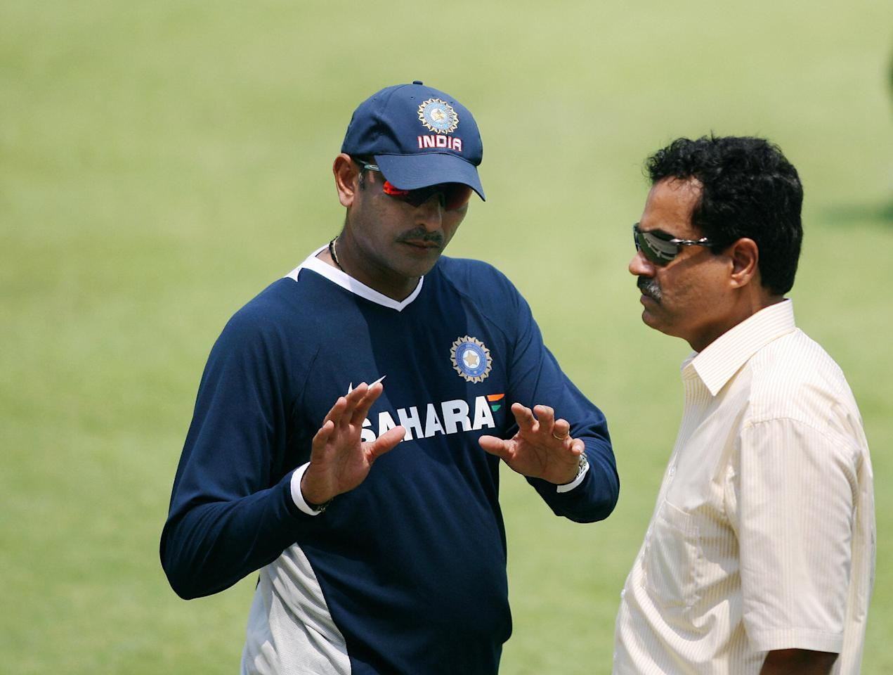 Kolkata, INDIA: Indian chief selecter Dilip Vengsarkar (R) listen to team manager Ravi Shastri during net practice on the fourth day of a five-day conditioning camp at Eden Gardens in Kolkata, 05 May 2007.  The Indian team is preparing to head for Bangladesh to play a One Day International and Test series.   AFP PHOTO/Deshakayan CHOWDHURY  (Photo credit should read DESHAKALYAN CHOWDHURY/AFP/Getty Images)