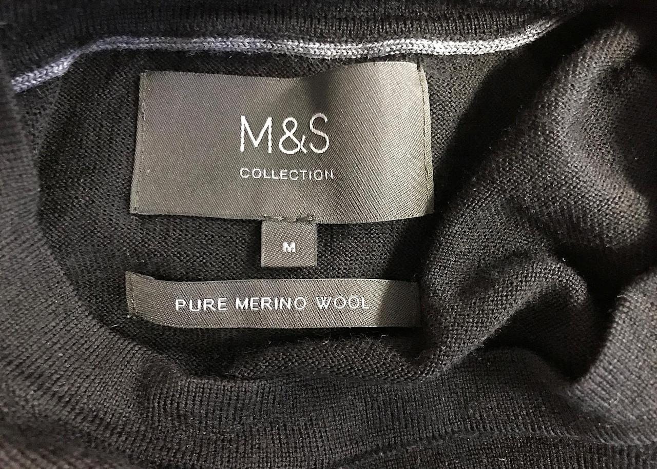 A Marks and Spencer label is seen on an item of men's clothing in London, Britain, May 23, 2018. REUTERS/Toby Melville