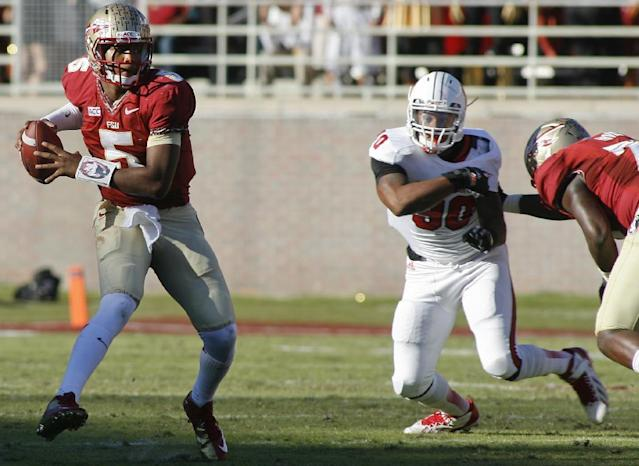 Florida State quarterback Jameis Winston (5) makes a cut to avoid a sack by North Carolina State defensive end Mike Rose (90) in the second quarter of an NCAA college football game on Saturday, Oct. 26, 2013, in Tallahassee, Fla. (AP Photo/Phil Sears)