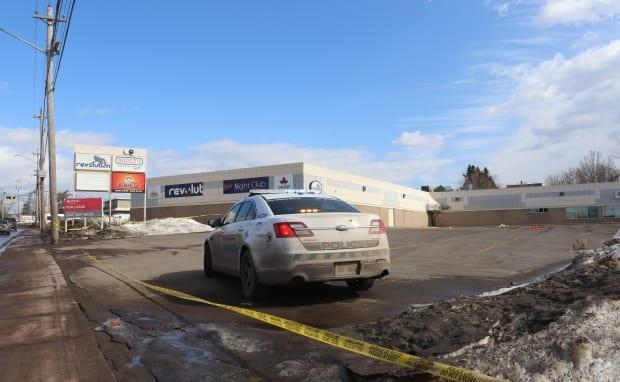 Police had taped off a parking lot outside the Dooly's location on Elmwood Drive in Moncton.