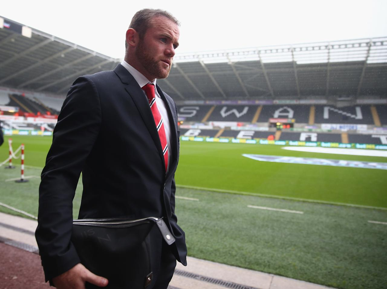 SWANSEA, WALES - AUGUST 17: Wayne Rooney of Manchester United walks to the dressing room ahead of the Barclays Premier League match between Swansea City and Manchester United at the Liberty Stadium on August 17, 2013 in Swansea, Wales. (Photo by Michael Steele/Getty Images)