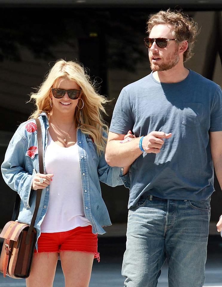 """According to <i>OK!</i>, Jessica Simpson is sporting a very noticeable """"baby bump."""" The mag notes that Simpson, who's ready to tie the knot with fiance Eric Johnson, """"looks like she's about 25 weeks along,"""" and that """"her priority now is to be a wife and a mother."""" For when Simpson will finally make the announcement, and details about her plans to be a pregnant bride, see what one of her pals reveals to <a href=""""http://www.gossipcop.com/jessica-simpson -pregnant-july-2011-baby-bump-pregnancy-eric-johnson/"""" target=""""new"""">Gossip Cop</a>. <a href=""""http://www.splashnewsonline.com"""" target=""""new"""">Splash News</a> - June 5, 2011"""